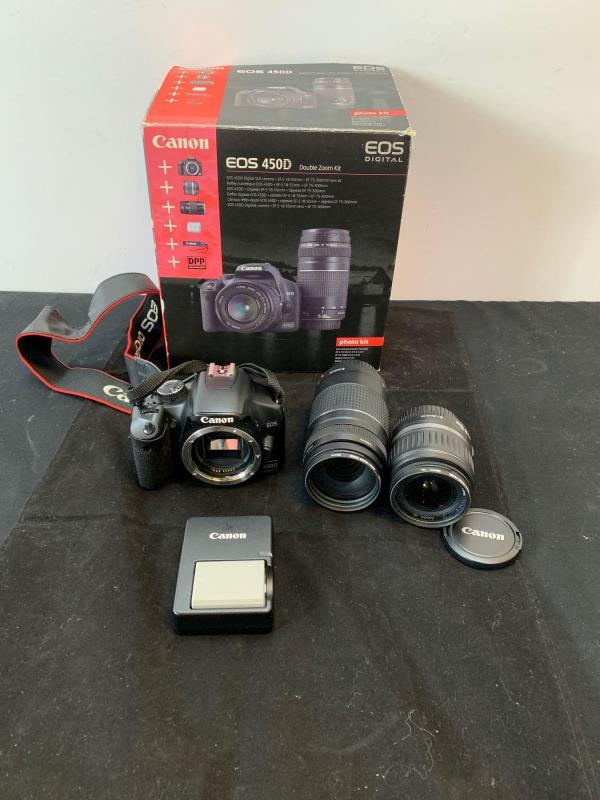 A boxed Canon EOS 450D double zoom kit - Price Estimate: £ - £