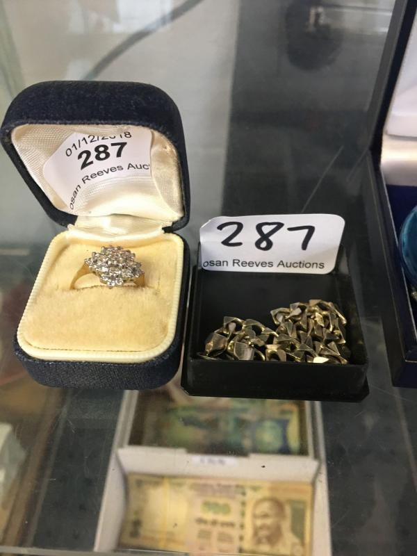 A 9ct gold cluster ring, a silver bracelet and a blue glass perfume
